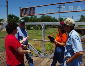 Becky McCray working with a group of stream experts on a small town project.