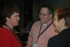 Becky talking with Phil Gerbyshak and Denise Wakeman at a conference.