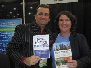 Authors Simon Salt and Becky McCray show off at BlogWorld. Photo by Shashi Bellamkonda