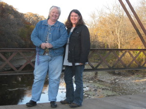 Deb Brown and Becky McCray on a rural bridge in Iowa