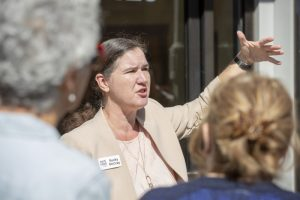 Becky McCray leads a group out of the meeting room to apply ideas on Main Street in Colfax, Washington
